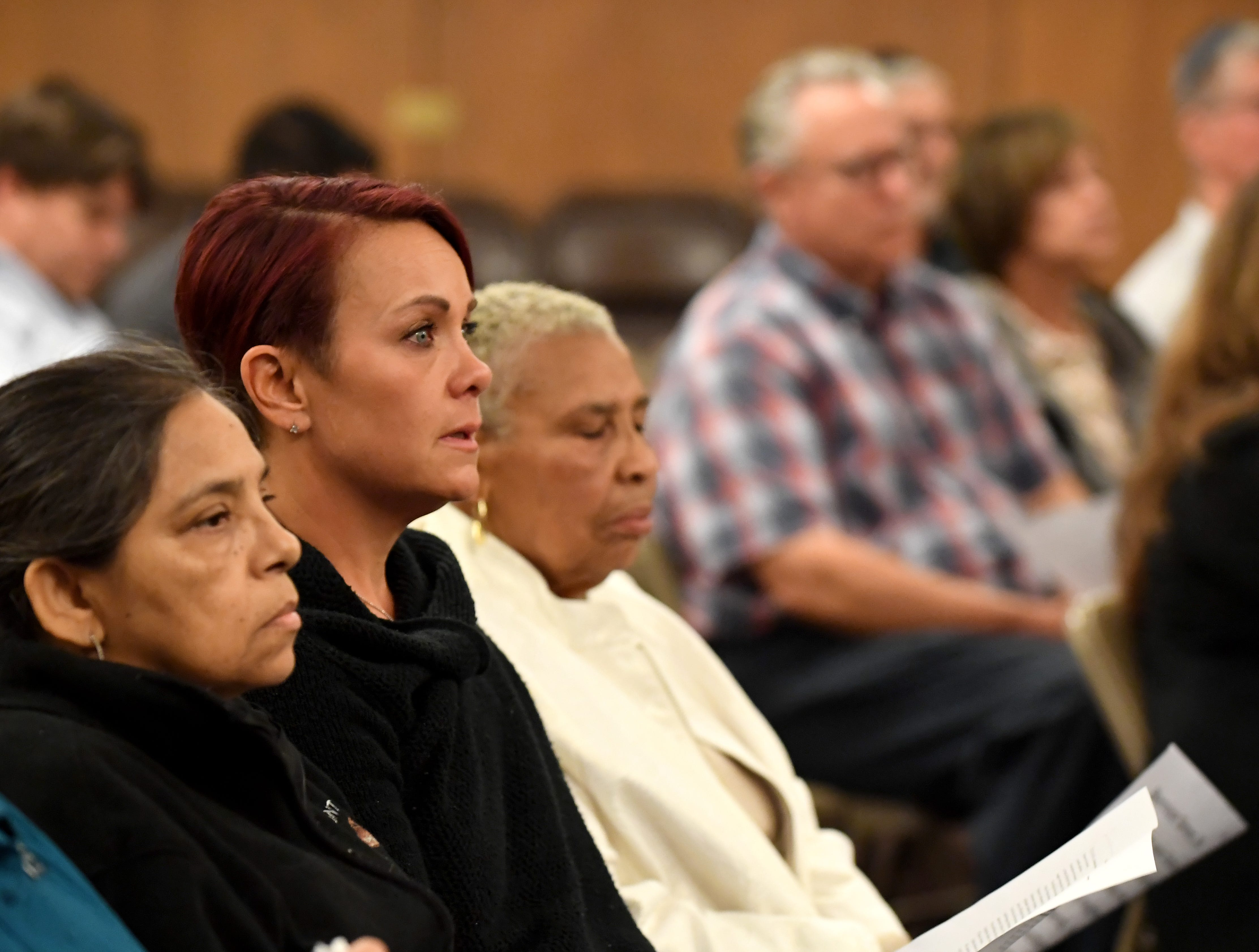 Salinas resident Joanne Robbins (second from left) listens during a gathering at Temple Beth El on Monday night to mourn those killed in the Pittsburgh synagogue shooting.