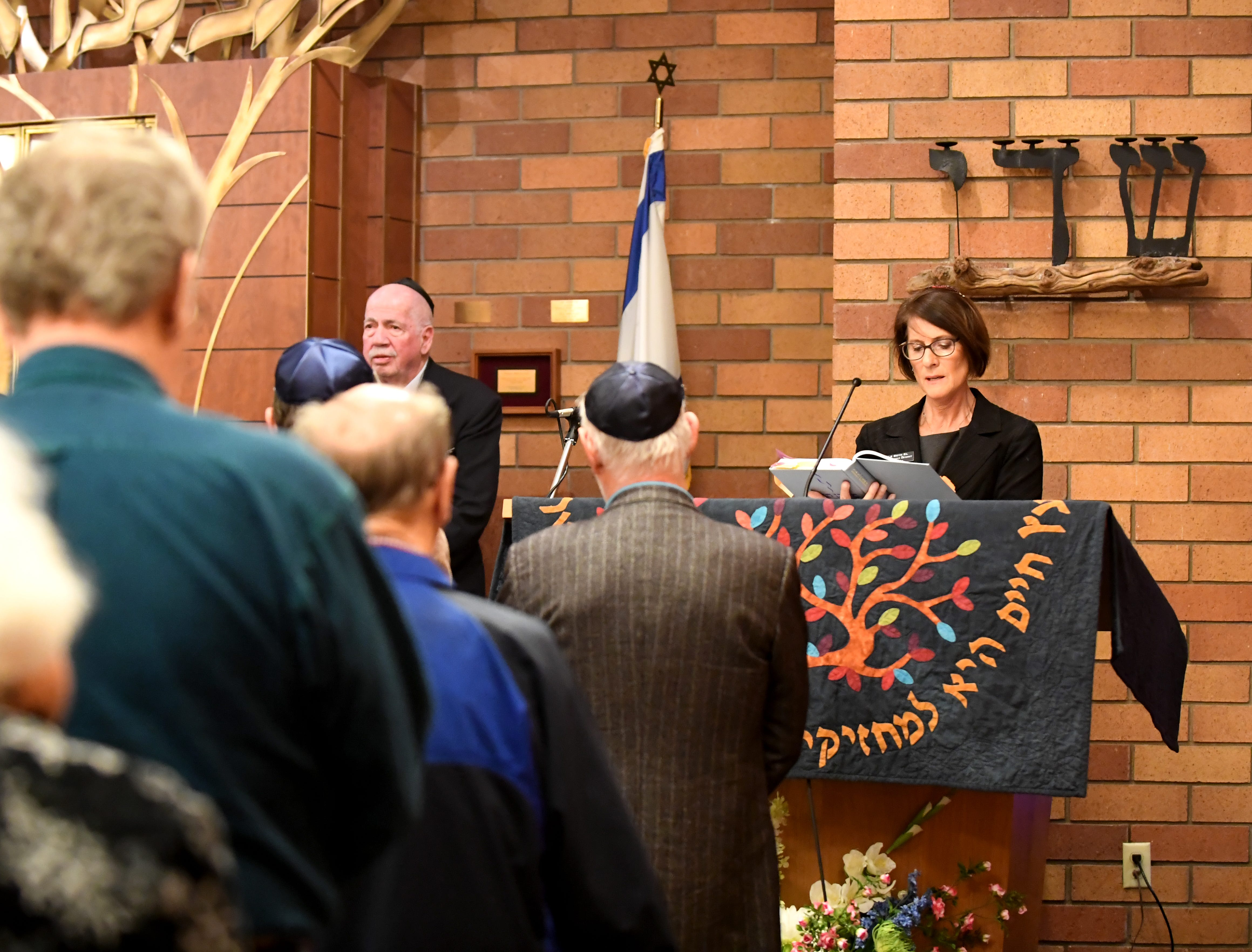 Cantor Margaret Bruner leads a gathering at Temple Beth  El in Salinas Monday to mourn the loss of 11 people killed at a Pittsburgh synagogue.