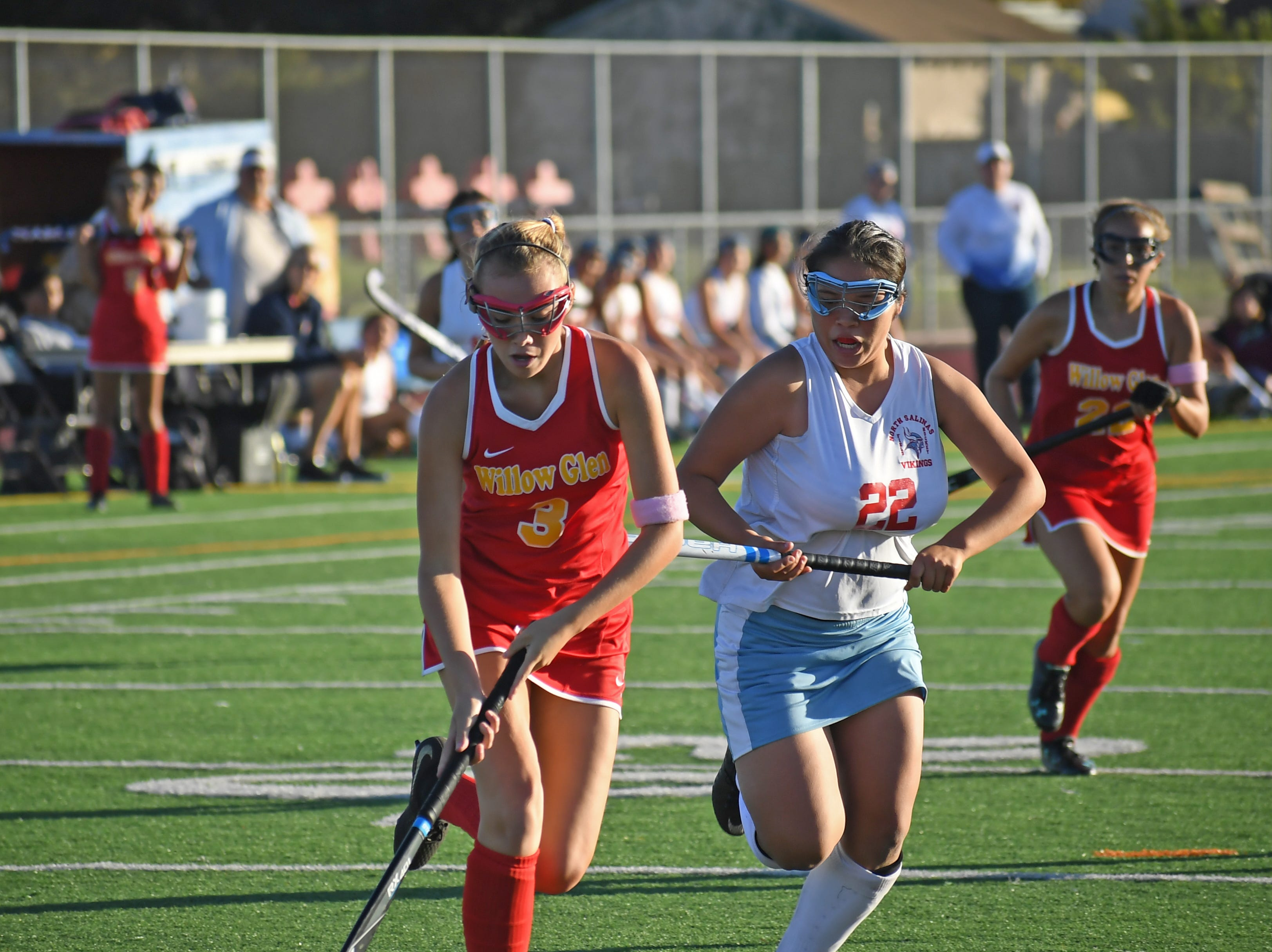 Sophomore Precious Eady (22) sprints to defend a run by one of the Willow Glen midfielders.