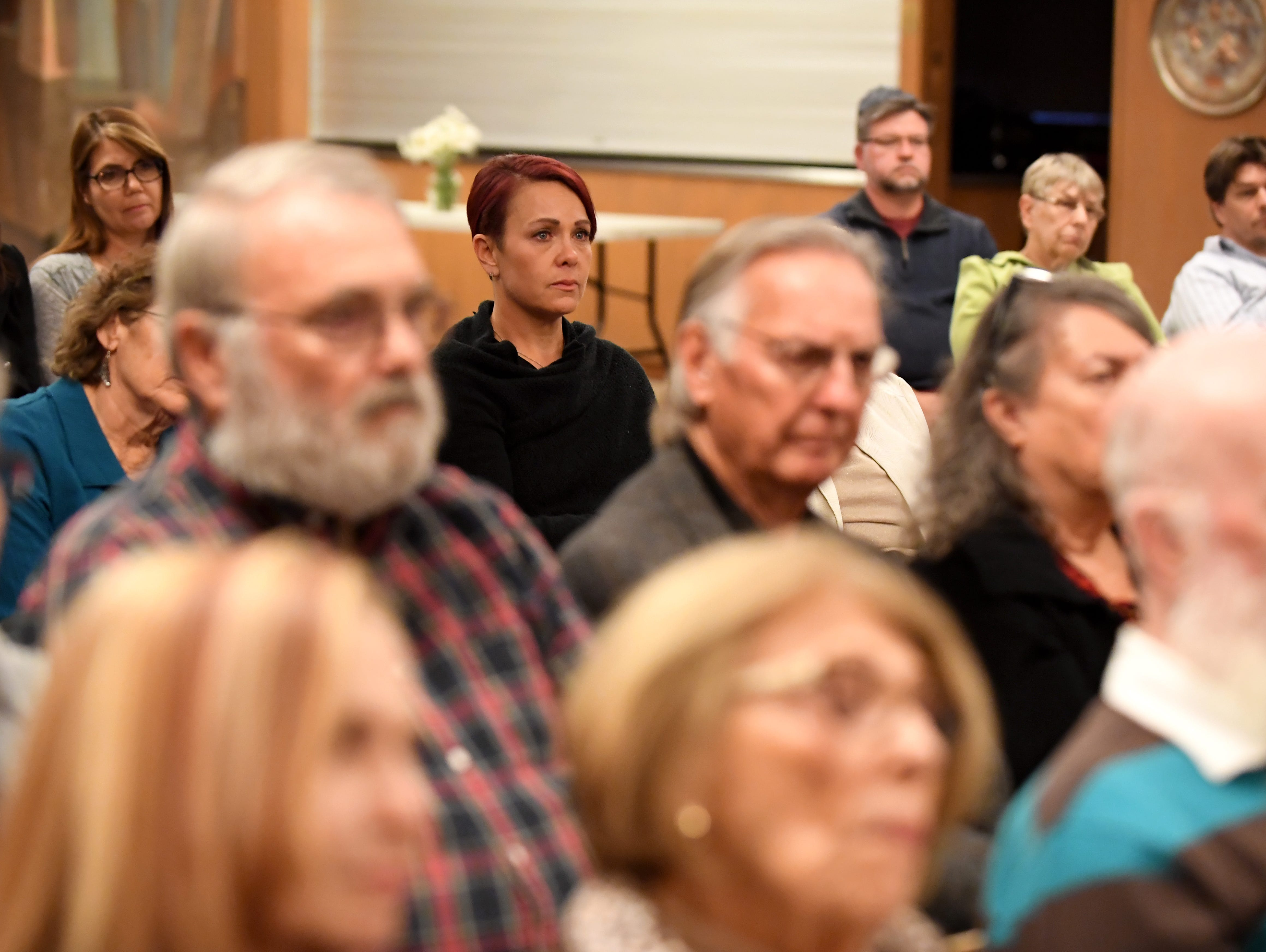 Salinas resident Joanne Robbins (middle) listens during a gathering at Temple Beth El on Monday night to mourn those killed in the Pittsburgh synagogue shooting.
