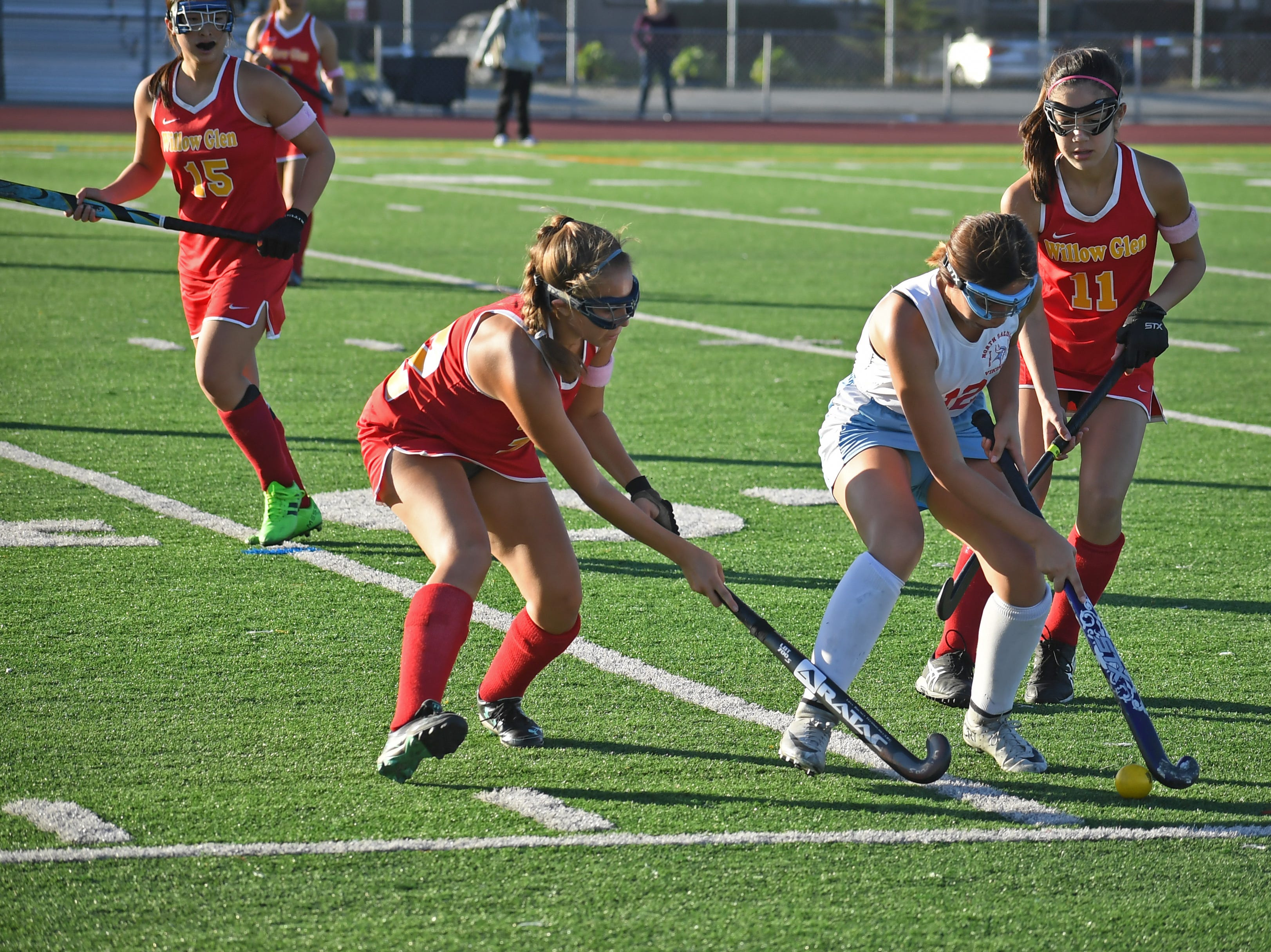 Midfiedler Yesenia Solis (12) protects the ball from two Willow Glen forwards.