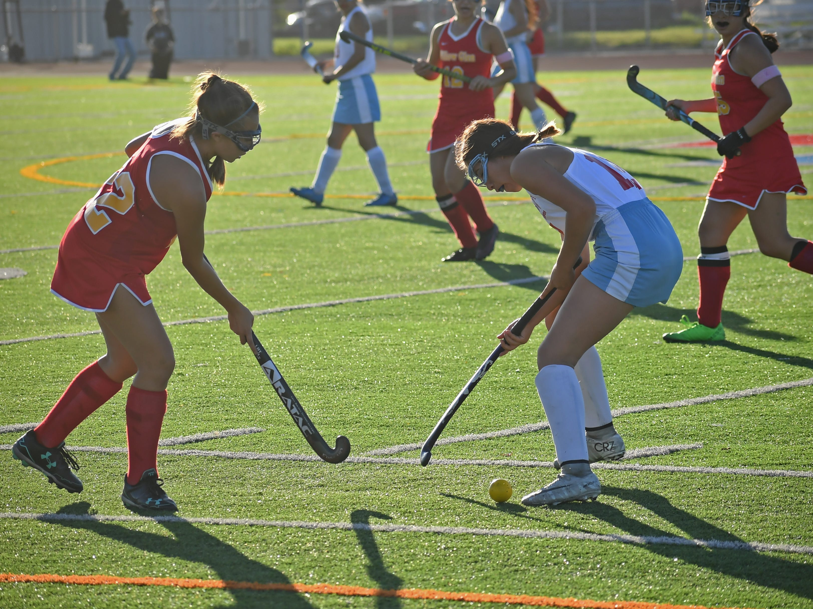 Midfielder Yesenia Solis (12) steals the ball from one of the Willow Glen midfielders.