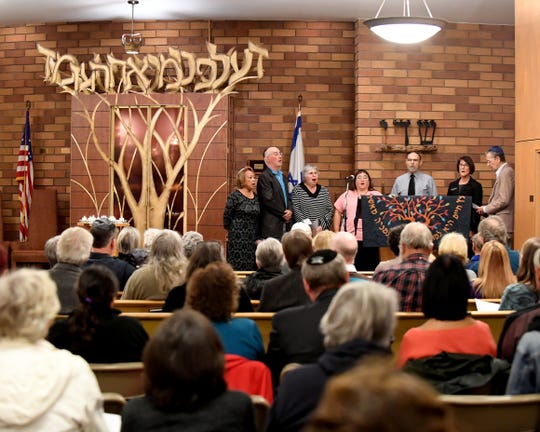 The choir sings toward the end of a gathering at Temple Beth El in Salinas on Monday to mourn the 11 people killed in a Pittsburgh synagogue Saturday.