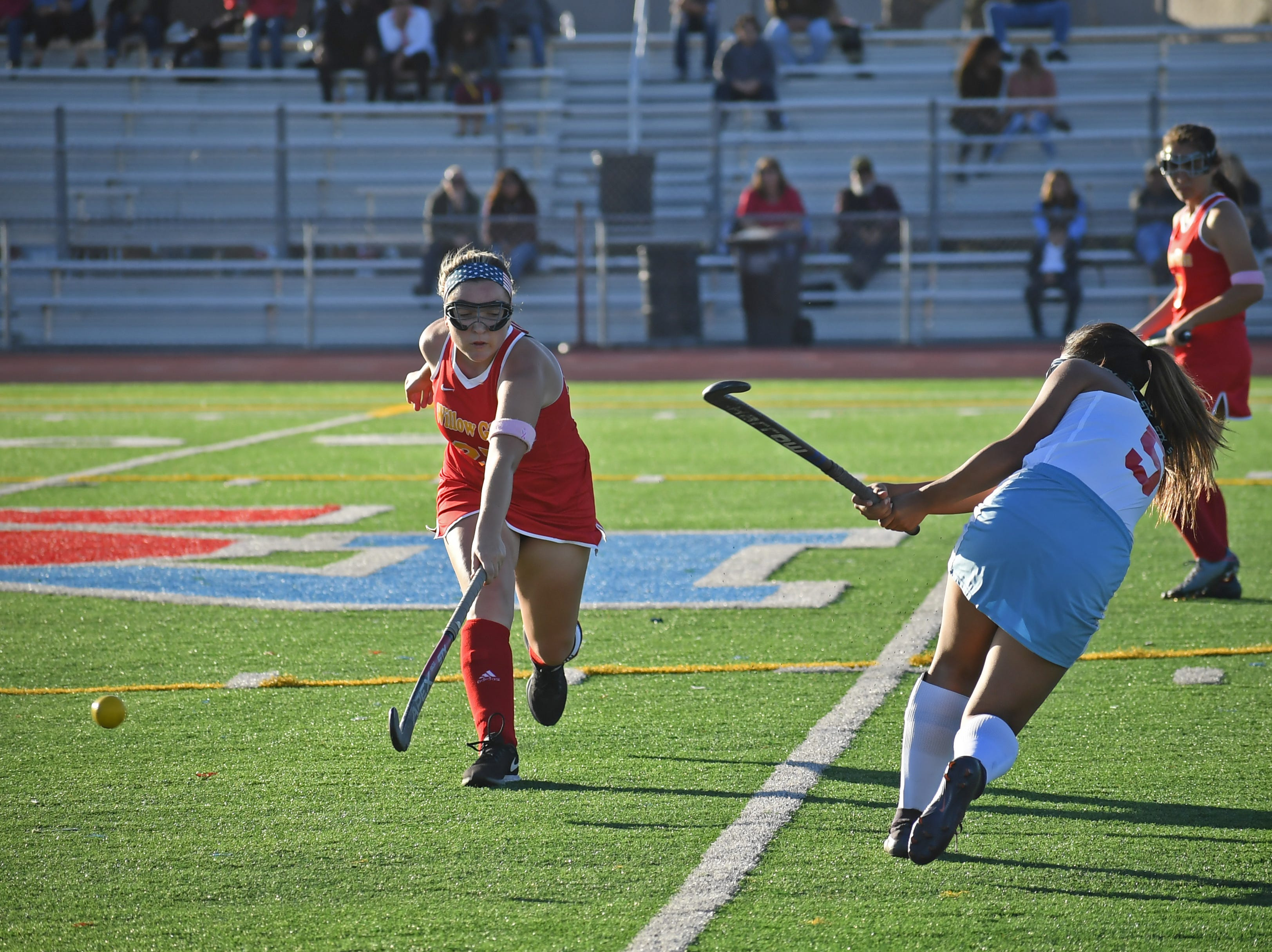 Midfielder Samantha Herrera (5) fires a pass past one of the Willow Glen midfielders.