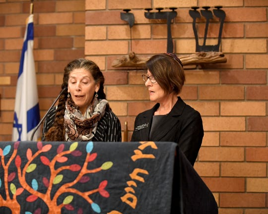 Cantor Alisa Fineman of Congregation Beth Israel in Carmel and Cantor Margaret Bruner of Temple Beth El in Salinas lead a gathering in Salinas Monday evening to mourn the 11 people killed at a Pittsburgh synagogue Saturday.