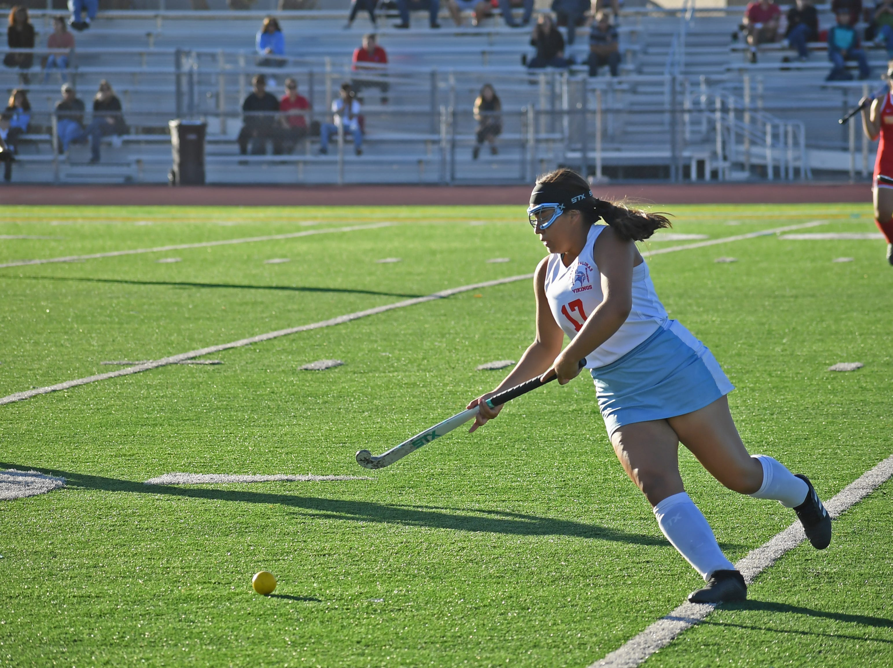 Midfielder Dahrely Alvarez (17) takes a pass from Emily Ruelas down the left side of the field.