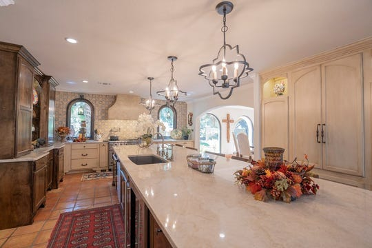 This huge quartz island at 1530 River Ridge Lane offers counter and bar space.