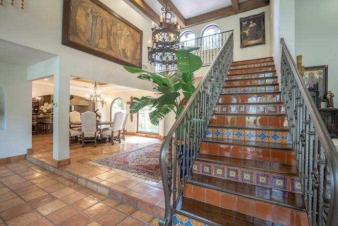 The subtle tile work on the stairs at 1530 River Ridge Lane draws the eye.