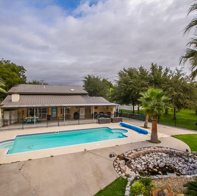 Swim with the dolphins at this unique lake home for sale in San Angelo