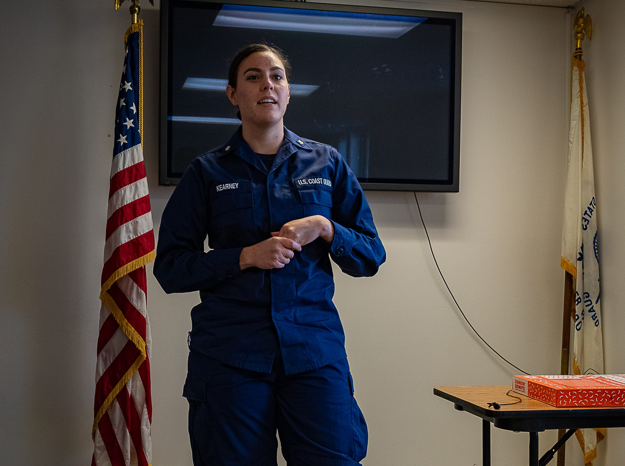 Petty Officer 3rd Class Shannon Kearney, a member of the U.S. Coast Guard Station Portsmouth Public Affairs Office, offers a quick briefing before embarking on a cold-water survival demonstration in Cape Charles, Virginia, on Tuesday, Oct. 30, 2018.
