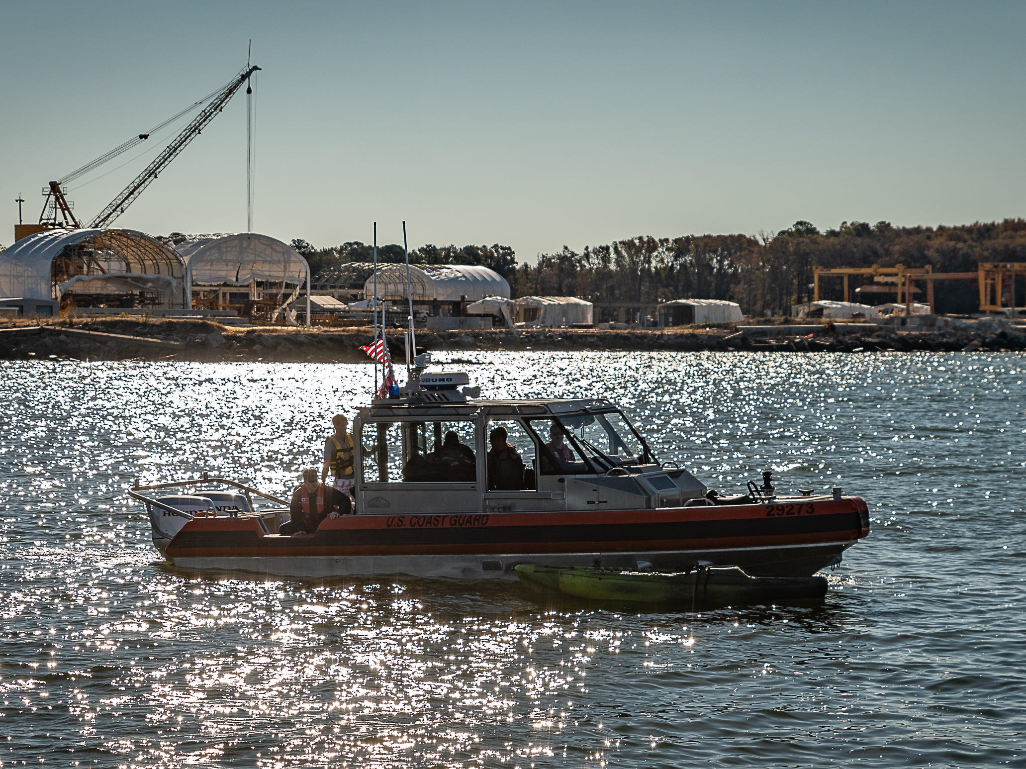 One of the two U.S. Coast Guard boats used during the cold-water survival demonstration patrols the water near Cape Charles, Virginia on Tuesday, Oct. 30, 2018.