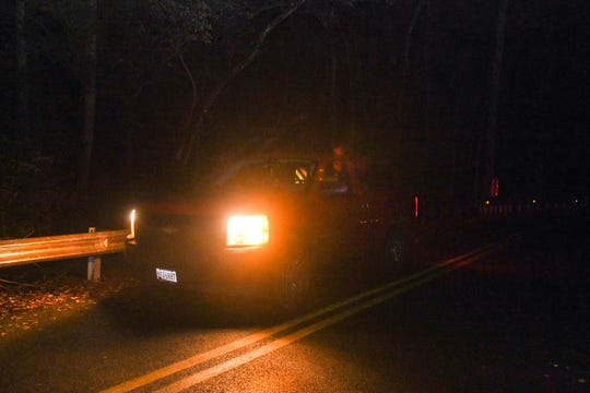 Daily Times reporter Ricky Pollitt puts his keys on the roof of his truck on a bridge in the Pocomoke Forest on Saturday, Oct 27, 2018. Legend says this will draw spirits or ghosts to the area.