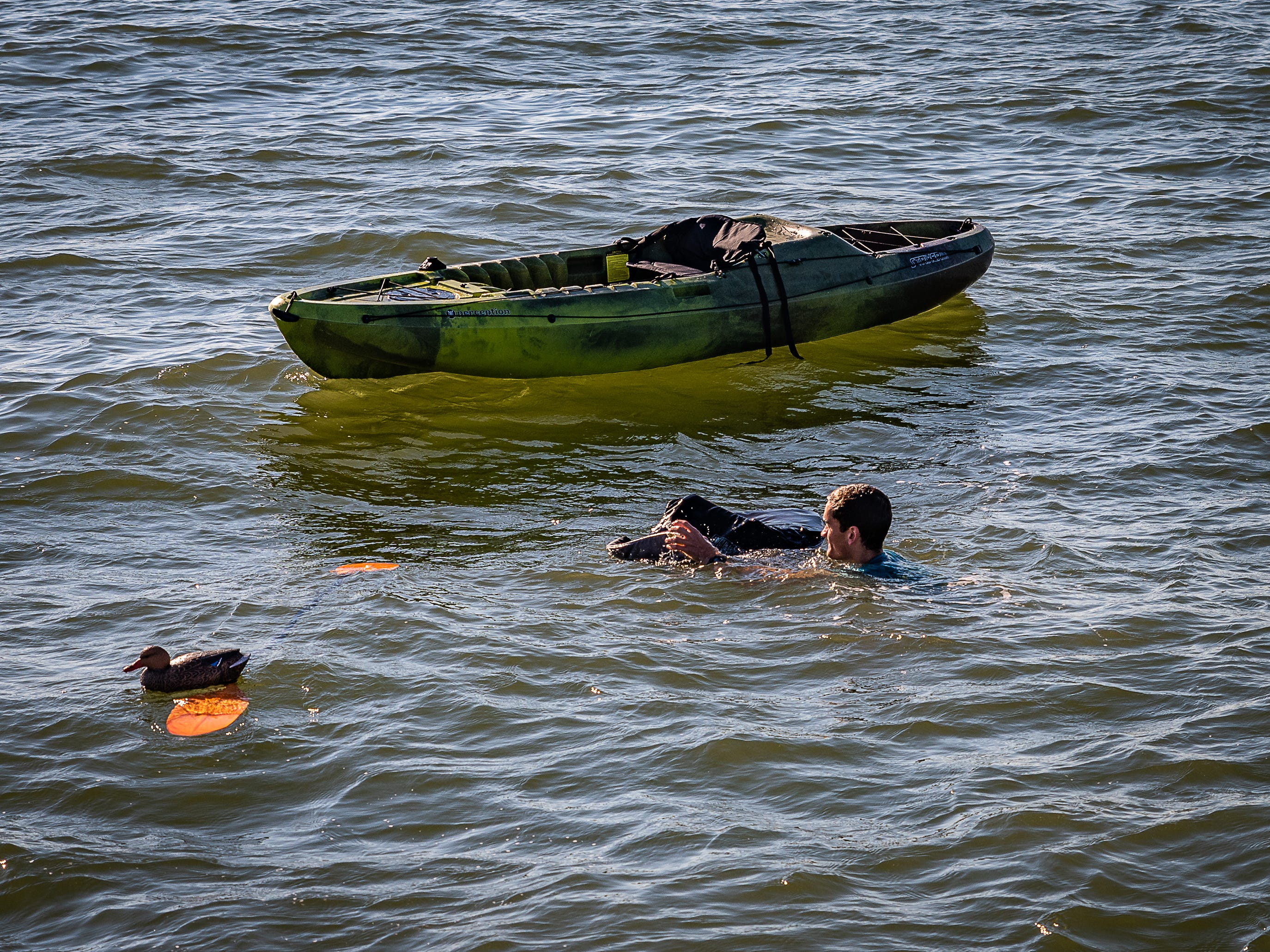 A U.S. Coast Guard member demonstrates survival techniques on Tuesday, Oct. 30, 2018 in Cape Charles, Virginia.