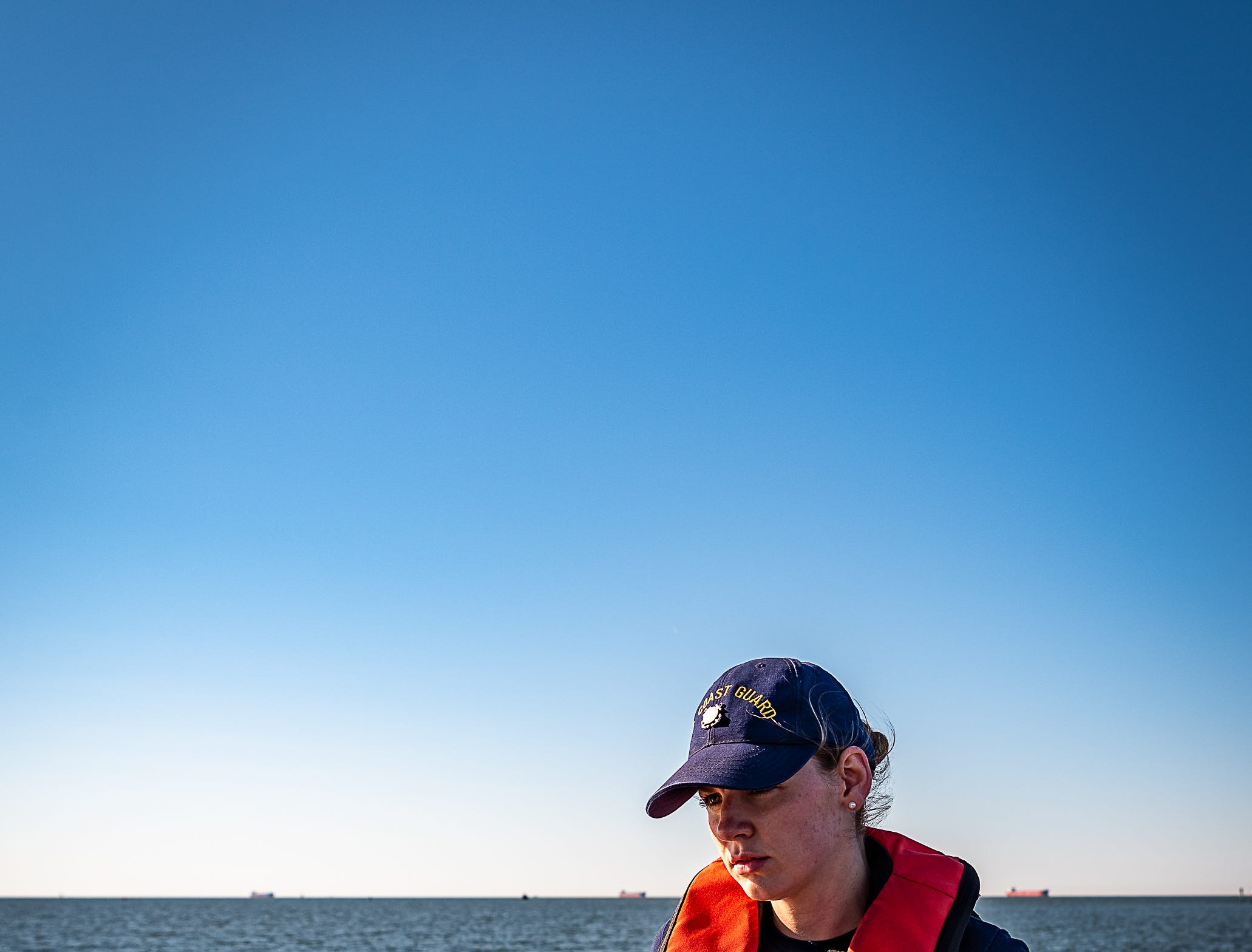 Seaman Jordan Lissy pauses during a cold-water survival demonstration on Tuesday, Oct. 30, 2018 U.S. Coast Guard in Cape Charles, Virginia.