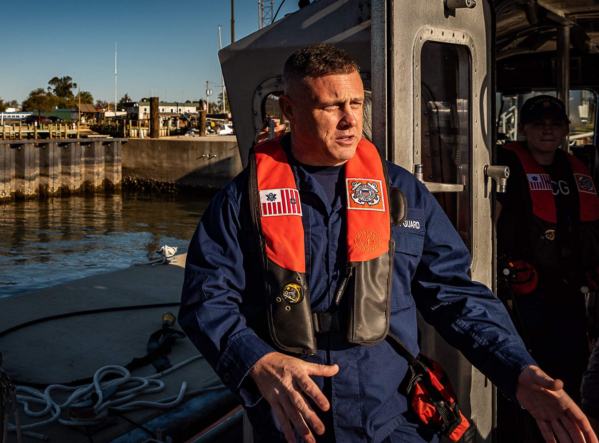 Lt. Gary George speaks during a U.S. Coast Guard cold-water demonstration in Cape Charles, Virginia on Tuesday, Oct. 30, 2018.