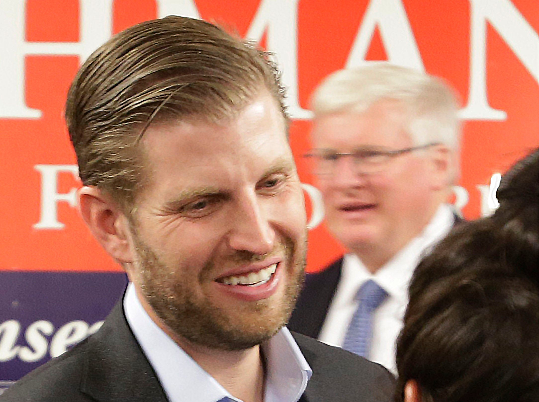 Eric Trump smiles while speaking to a Republican supporter as U.S. Representative Glenn Grothman, right, walks in the background during a campaign rally at the GOP Headquarters, Tuesday, October 30, 2018, in Sheboygan, Wis.  Trump was in Sheboygan to rally support for Wisconsin Republicans.
