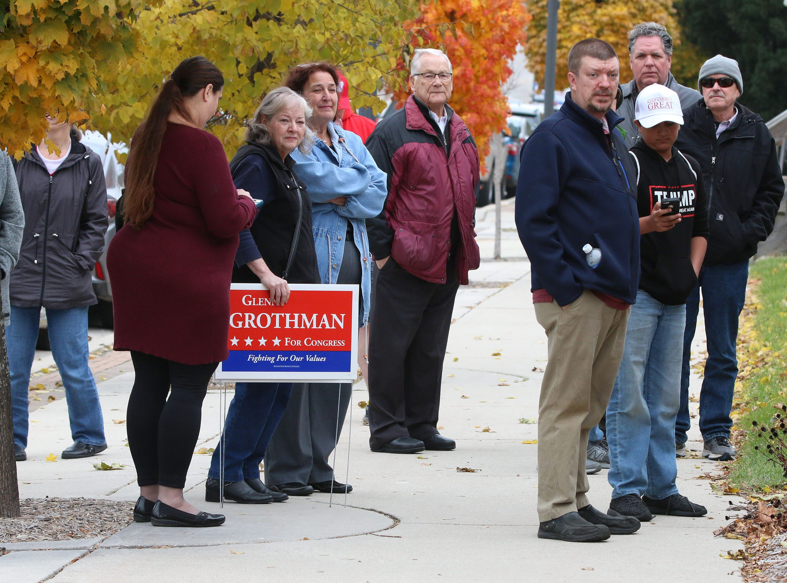 People wait for entry to the GOP campaign rally at the GOP Headquarters, Tuesday, October 30, 2018, in Sheboygan, Wis.