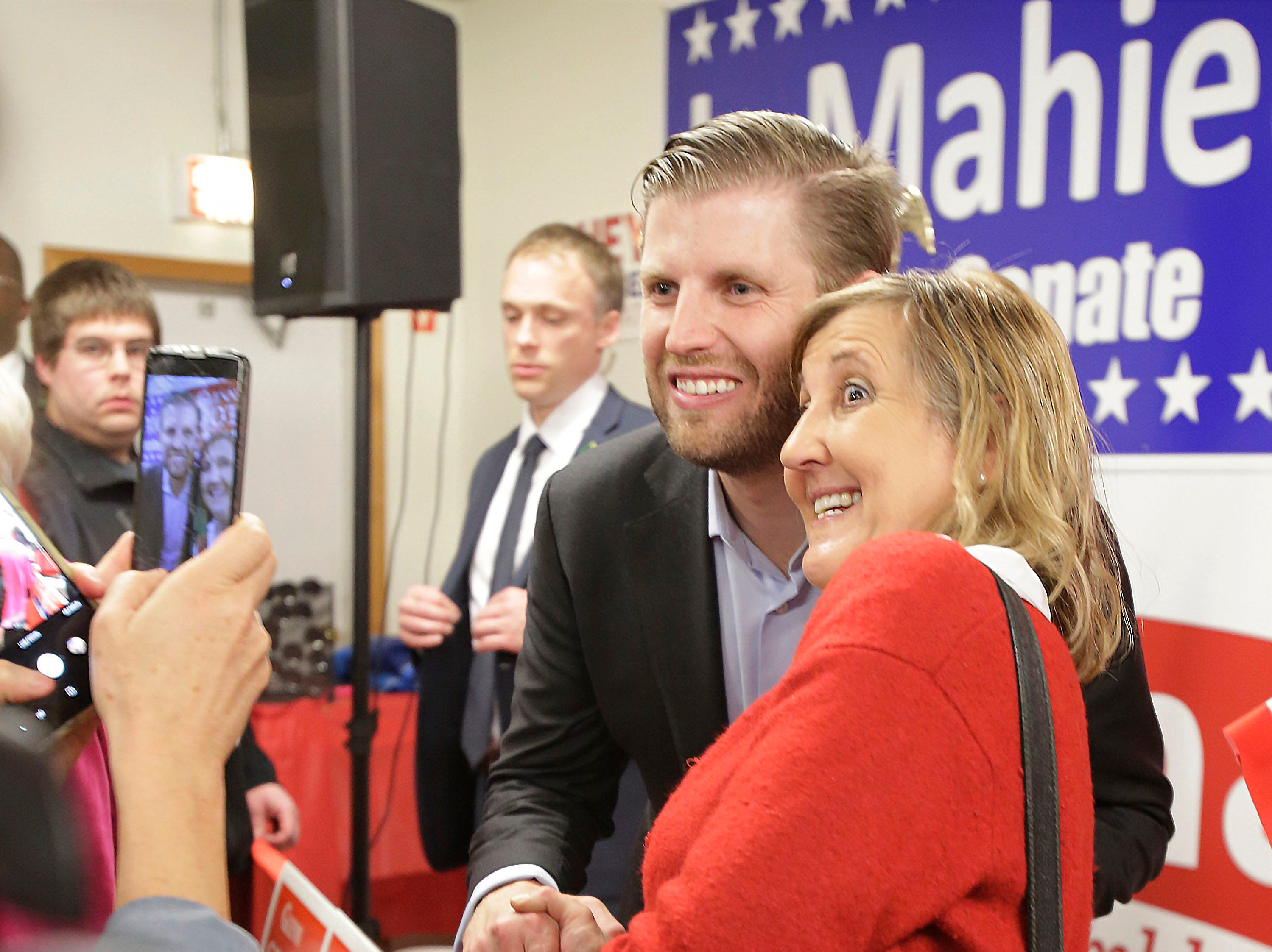 Brenda Wagner of Sheboygan, right, poses with Eric Trump, Tuesday, October 30, 2018, in Sheboygan, Wis. Trump was in Sheboygan to rally support for Wisconsin Republicans.