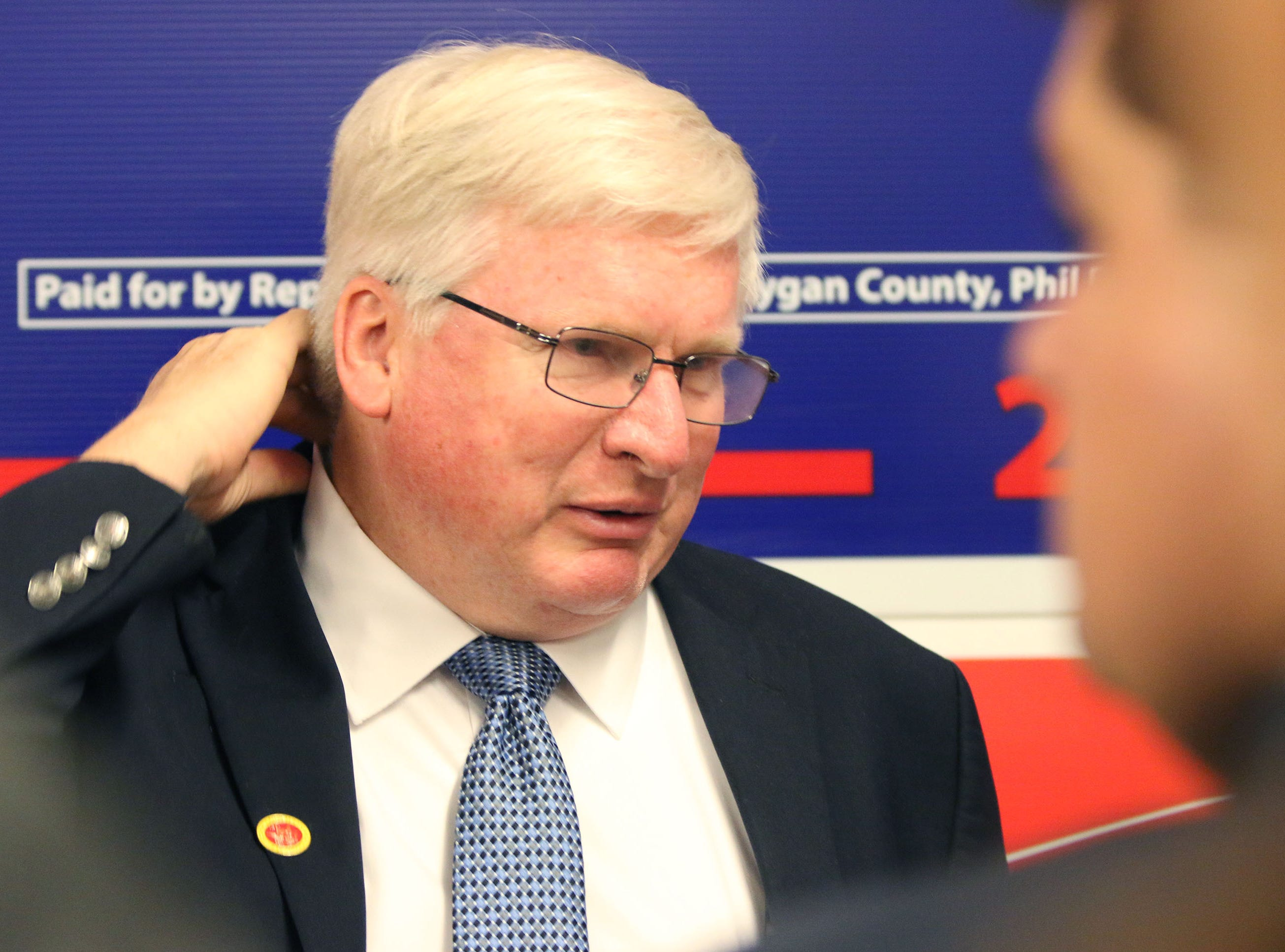 U.S. Representative Glenn Grothman adjusts his collar during a campaign stop at the GOP headquarters, Tuesday, October 30, 2018, in Sheboygan, Wis. Grothman and Eric Trump was in Sheboygan to rally support for Wisconsin Republicans.