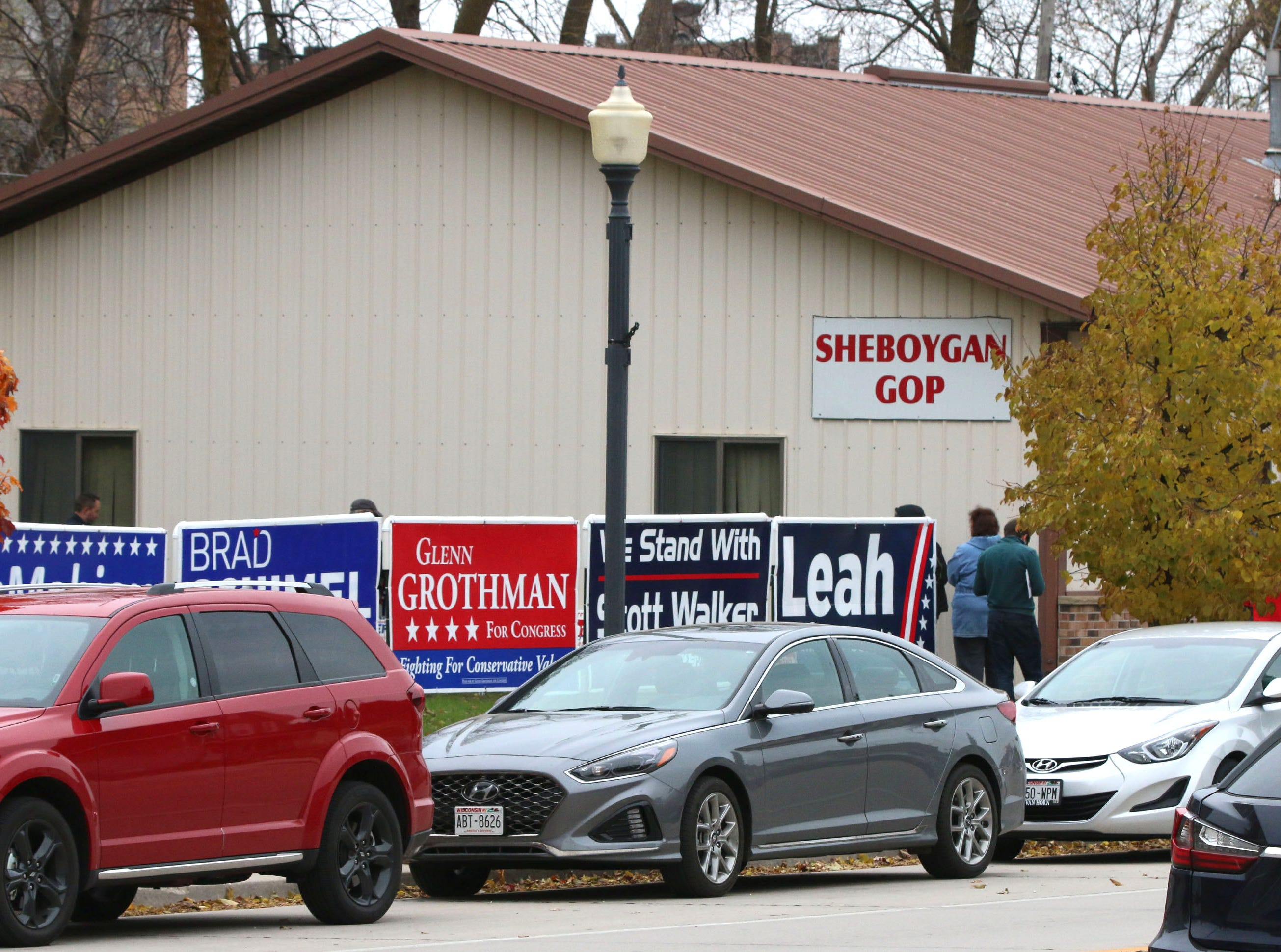 Cars line Indiana Avenue during a Republican rally at the GOP headquarters, Tuesday, October 30, 2018, in Sheboygan, Wis.