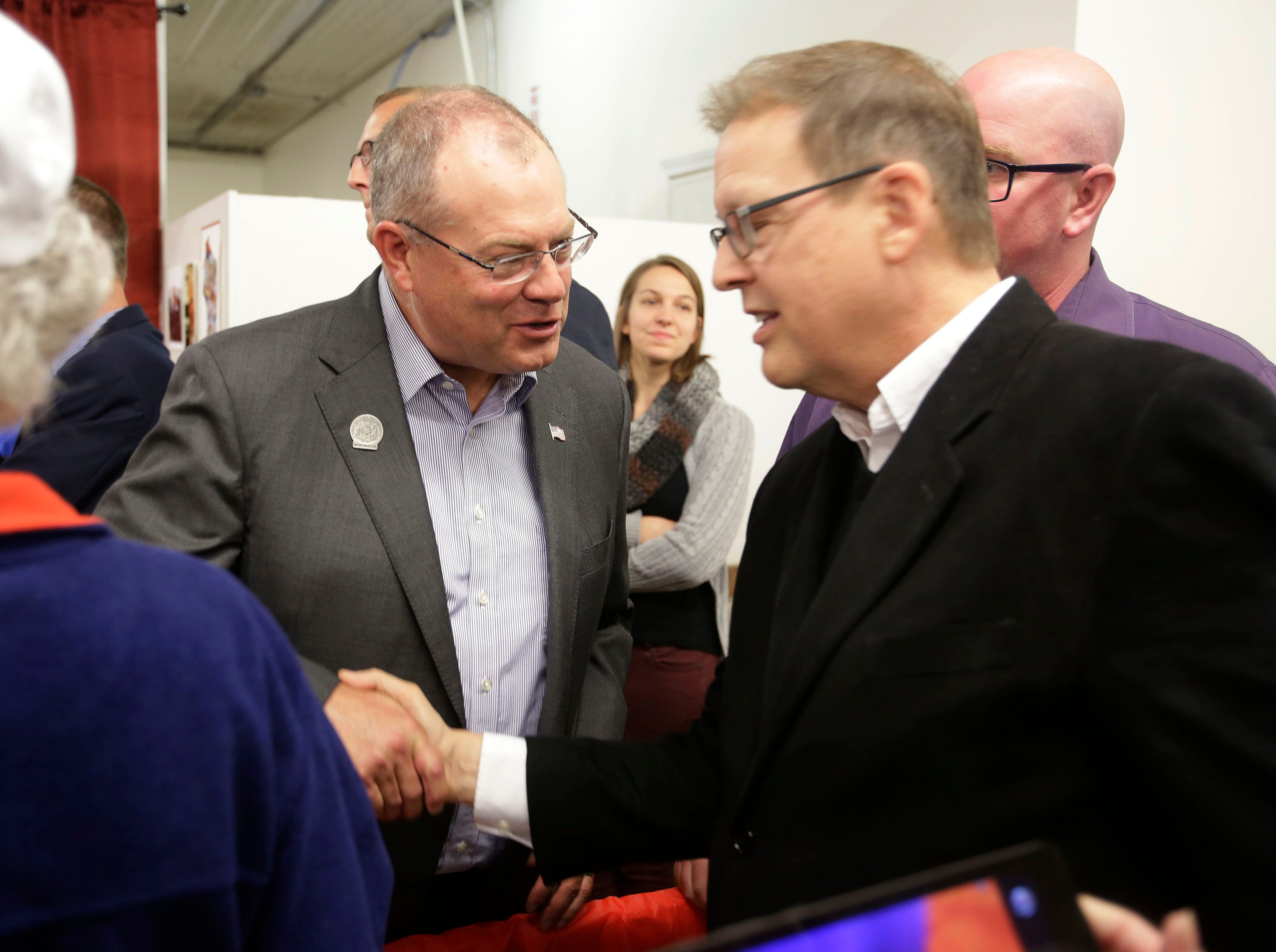 State Representative Terry Katsma, left, speaks to a supporter at a campaign rally at the GOP headquarters, Tuesday, October 30, 2018, in Sheboygan, Wis.