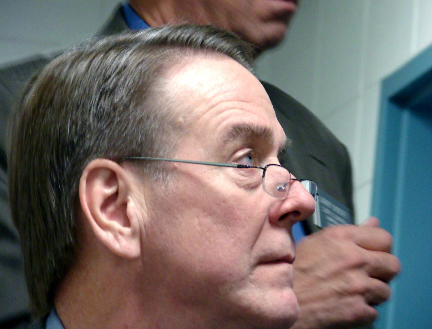 State Supreme Court Justice Steven Zinter, foreground, and state Sen. Garry Moore, D-Yankton, listen Tuesday, Dec. 5, 2006, during a tour of a new methamphetamine treatment center in Pierre, S.D. The two men are members of the state Corrections Commission. (AP Photo/Joe Kafka)