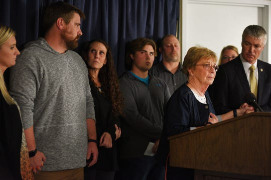 Attorney General of South Dakota Marty Jackley holds Lynette Johnson's hand while she addresses the media with her family after Rodney Berget is executed Monday, Oct. 29, at the South Dakota State Penitentiary in Sioux Falls.