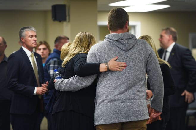 DCI victim witness specialist Cindy Schmit hugs Jesse Johnson, RJ Johnson's son, after Rodney Berget is executed Monday, Oct. 29, at the South Dakota State Penitentiary in Sioux Falls.