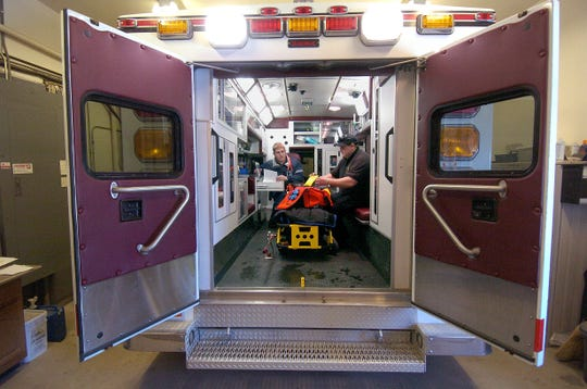 This is one of a series of photographs of Garretson Ambulance staff Justin Pfeifer, EMT intermediate, and Tyler Kientopf, EMT basic, and the ambulance. (Lloyd B. Cunningham/Argus Leader) 2 January 2008