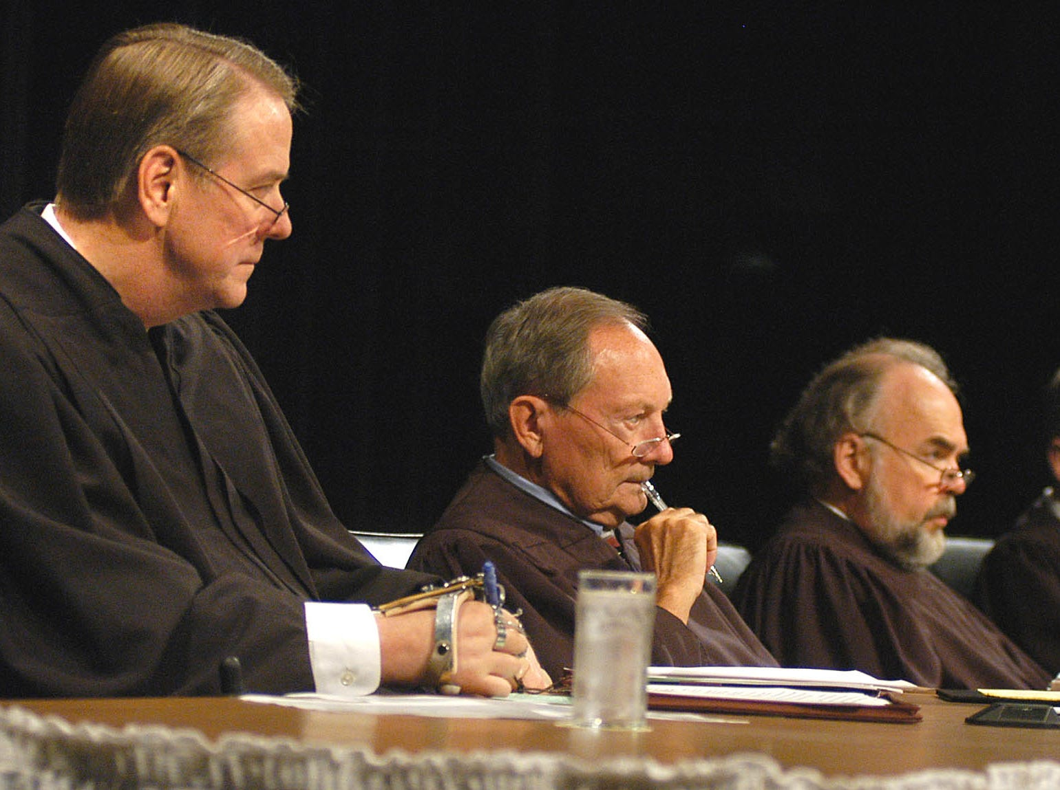 Justices, from left,  Steven Zinter, Richard Sabers, David Gilbertson and John Konenkamp listen to arguments in an appeal of a property rights dispute with the Lewis and Clark rural water pipeline Tuesday, Oct. 4, 2005, at the South Dakota Supreme Court in Aberdeen, S.D. (AP Photo/Doug Dreyer)