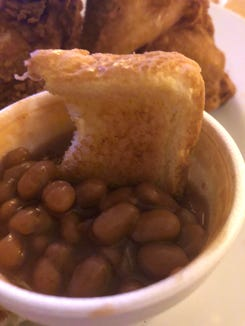 Texas toast (aka edible napkin) bathing in beans at Botski's.