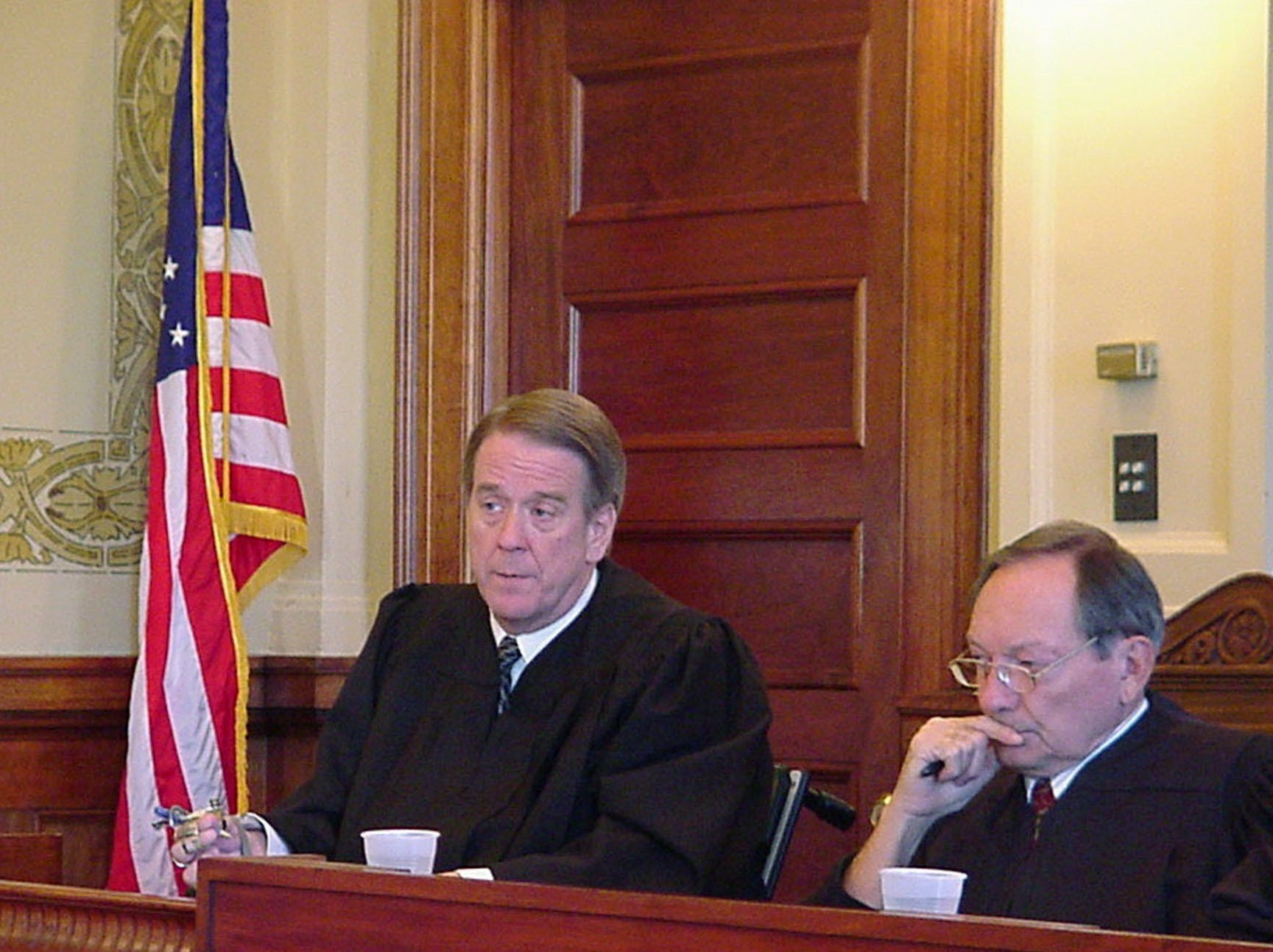 State Supreme Court Justices Steven L. Zinter, left, and Richard W. Sabers listen Tuesday, Nov. 18, 2003, at Pierre, S.D., during arguments in a case involving fees for court-appointed attorney Veronica Duffy. Duffy claims Seventh Circuit judges wrongfully reduced a bill she submitted for representing two criminal defendants.  (AP Photo/Joe Kafka)