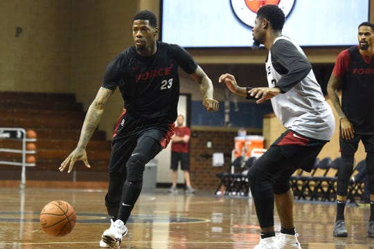 DeAndre Liggins (23) dribbles the ball past Malik Newman (7) at the Sanford Pentagon in Sioux Falls, S.D., Tuesday, Oct. 30, 2018.
