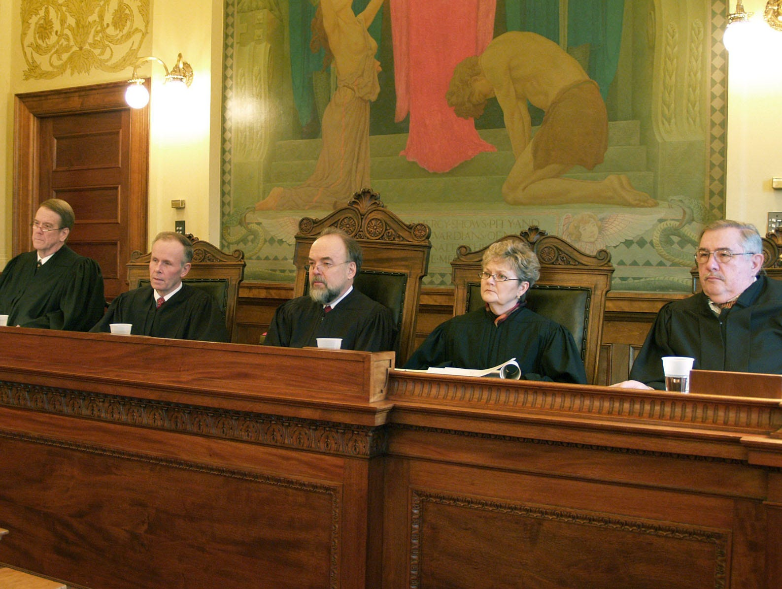 The state Supreme Court, seen Jan. 10, 2006, at Pierre, S.D., during a hearing over a man who was fired for drinking on the job, issued a ruling Thursday, March 9, 2006, that said he was improperly fired. From left are Justice Steven L. Zinter, Justice John K. Konenkamp, Chief Justice David Gilbertson, Justice Judith Meierhenry, and acting Justice Robert A. Miller. (AP Photo/Joe Kafka)