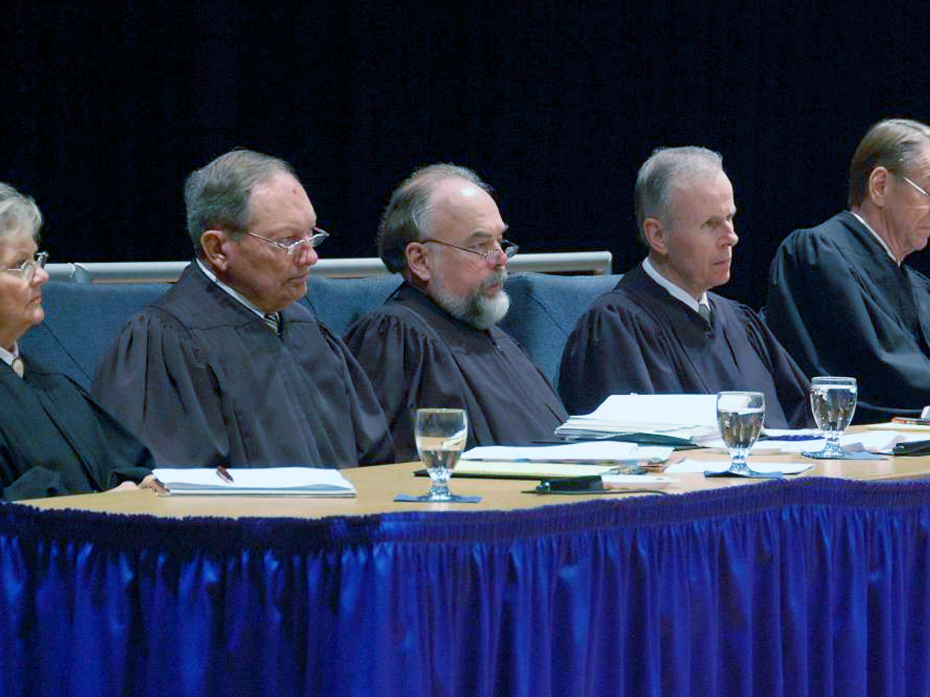 The South Dakota Supreme Court hears oral arguments Monday, Sept. 29, 2008, in Brookings, S.D. Pictured are Justices Judith Meierhenry, Richard Sabers, David Gilbertson (chief justice), John Konenkamp and Steven Zinter.  (AP Photo/Carson Walker)