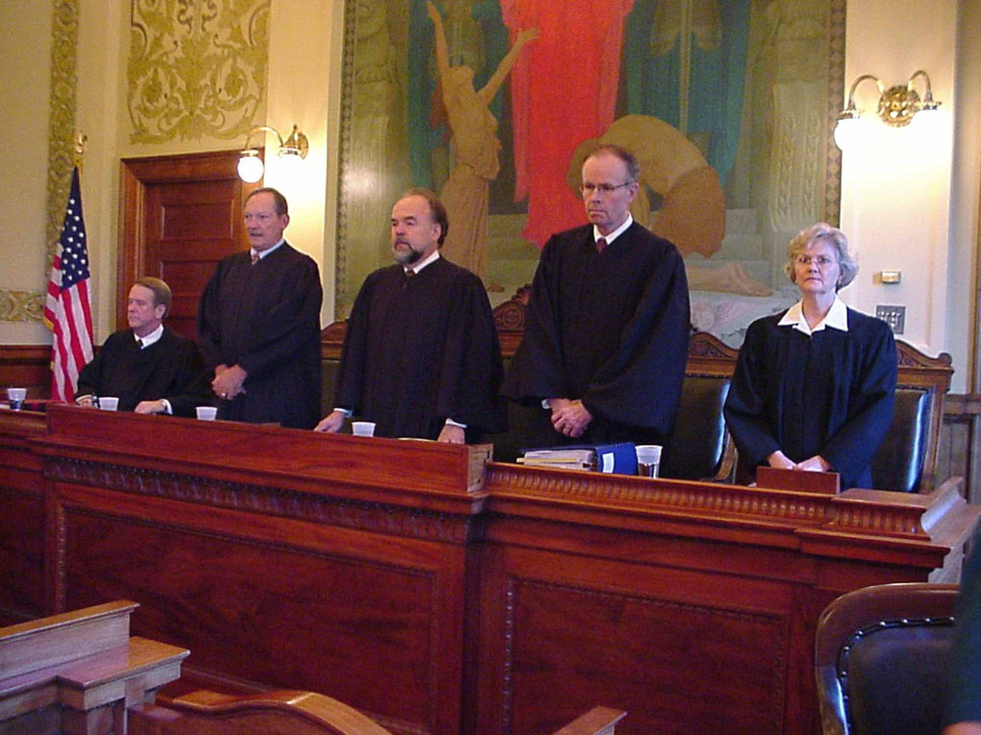 ** FILE ** The South Dakota Supreme Court, shown at Pierre, S.D., in this Aug. 26, 2003, file photo, has ruled that an unlimited homestead exemption that is designed to protect older South Dakotans from loss of their homes to creditors is unconstitutional. There was no immediate word Thursday if the state Revenue Department will offer remedial legislation next year. Shown, from left, Justices Steven Zinter, Richard W. Sabers, David Gilbertson, John K. Konenkamp and Judy Meierhenry. (AP Photo/Joe Kafka)