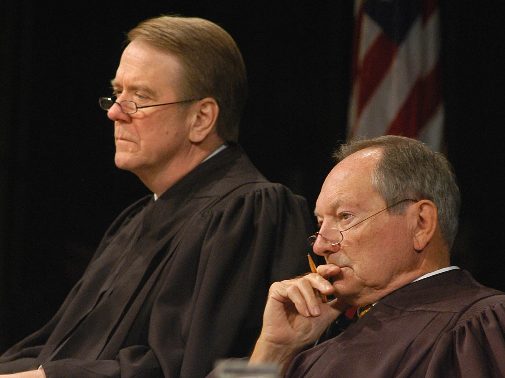 Justices Steven Zinter, left, and Richard Sabers listen to arguments appealing a 40 year sentence for a man who was video taping adolescent girls in his bathroom without their knowledge Wednesday, Oct. 5, 2005 at the South Dakota Supreme Court being held at Northern State University in Aberdeen, S.D. (AP Photo/Doug Dreyer)