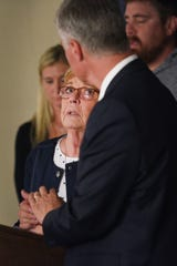Lynette Johnson looks at Attorney General of South Dakota Marty Jackley while addressing the media with her family after Rodney Berget is executed Monday, Oct. 29, at the South Dakota State Penitentiary in Sioux Falls.