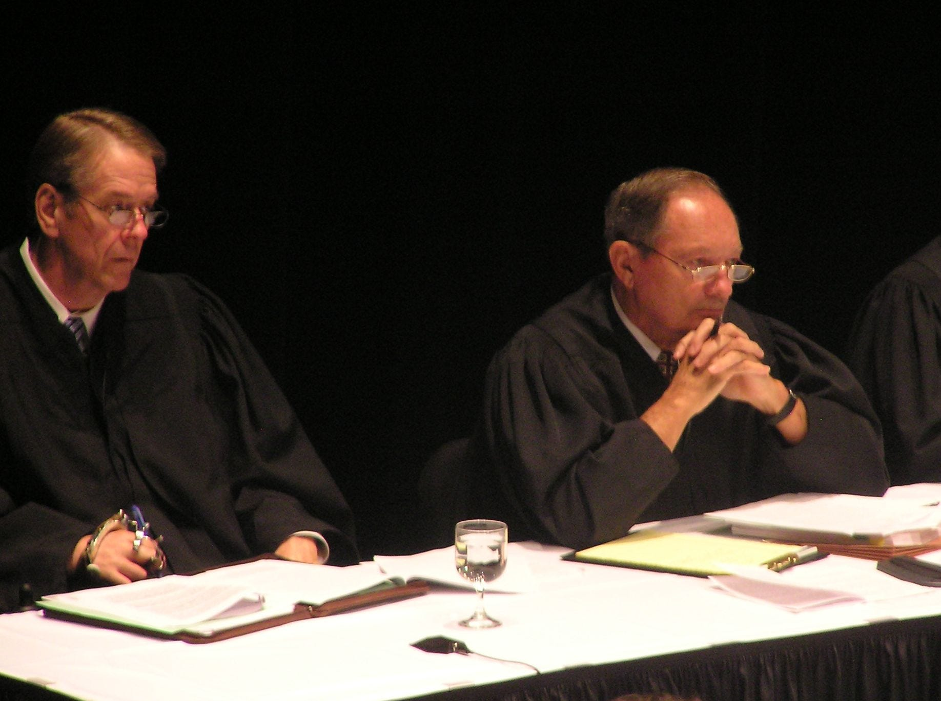 South Dakota Supreme Court Justices, from left, Steven Zinter and Richard Sabers and Chief Justice David Gilbertson listen to Bill Janklow (not pictured here) argue a case Monday, Oct. 2, 2006, in Sioux Falls, S.D. The former governor and congressman got his law license back in February after a 2003 manslaughter conviction for a fatal traffic accident. He's representing a father trying to regain custody of his daughter. (AP Photo/Carson Walker)