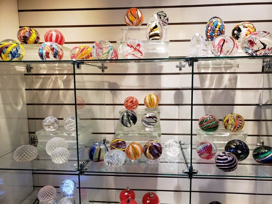 Many people collect the Bloodworths' paperweights, which have always been popular with Hot Glass patrons.
