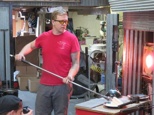 Gabe Bloodworth, Terry's son, fashions a piece of glass in Springfield Hot Glass's studio.