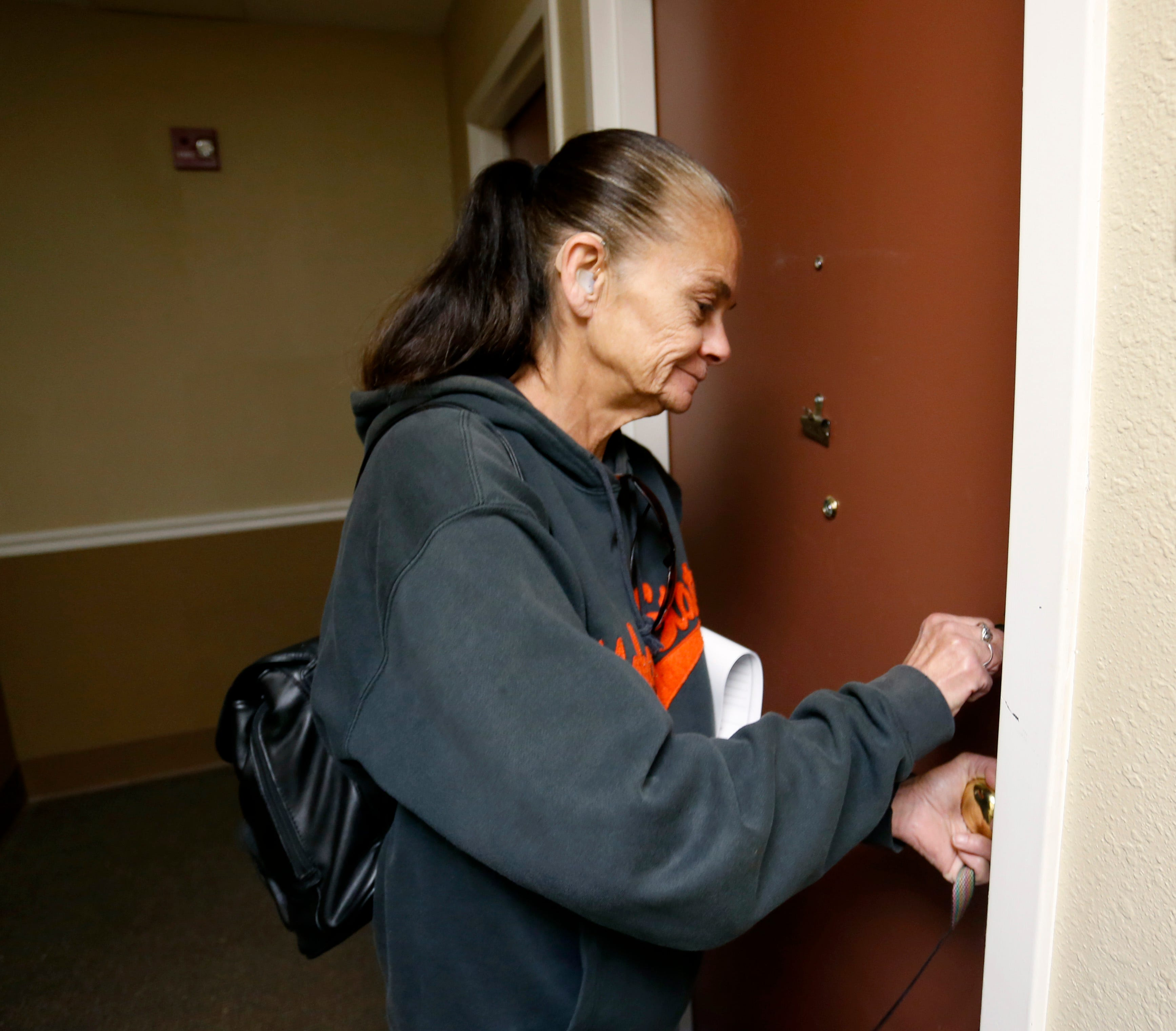 Julie Starbuck opens the door to her new studio apartment at the Franciscan Villa apartments on Wednesday, Oct. 24, 2018. Starbuck and Emily have been homeless for more than eight months.
