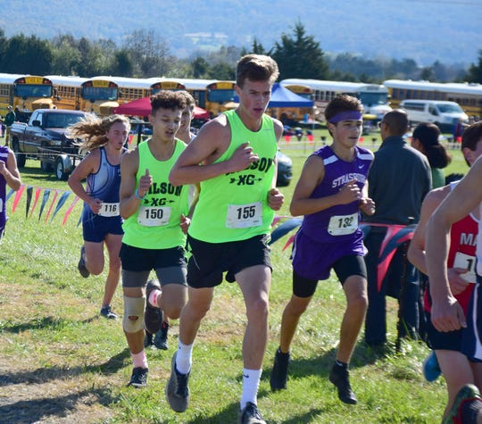 Wilson Memorial's Taylor Armstrong, left, and Rafe Shumate compete in the boys race at the VHSL Class 2, Region B Cross Country Championships on Tuesday, Oct. 30, 2018, at New Market Battlefield Park in New Market, Va.