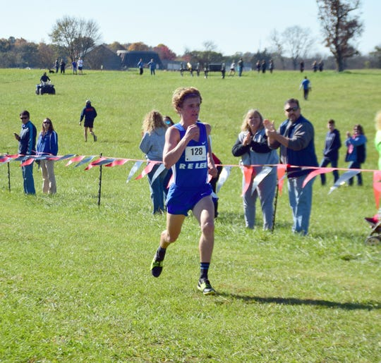 Robert E. Lee's Oliver Wilson-Cook is all alone as he reaches the finish line of the boys race at the VHSL Class 2, Region B Cross Country Championships on Tuesday, Oct. 30, 2018, at New Market Battlefield Park in New Market, Va. Wilson-Cook won his second straight region title.