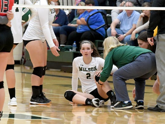 Wilson Memorial's Cassidy Davis sits up on the court after going down with an injury during a Shenandoah District championship match played in Fishersville on Monday, October 29, 2018.