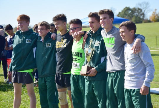 Wilson Memorial poses with the championship trophy after winning the boys race at the VHSL Class 2, Region B Cross Country Championships on Tuesday, Oct. 30, 2018, at New Market Battlefield Park in New Market, Va.