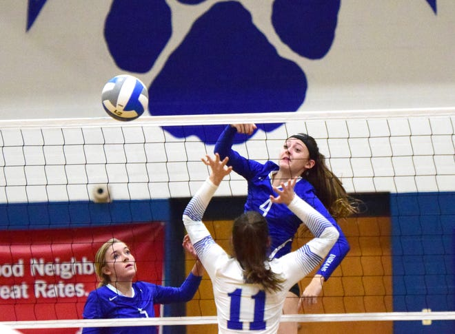 Fort Defiance's Leilani Goggin spikes the ball over Rockbridge County's McKenna Mohler during the first set of the championship match in the Valley District Volleyball Tournament on Monday, Oct. 29, 2018, at Rockbridge County High School in Lexington, Va. The Indians fell to the Wildcats in three sets.