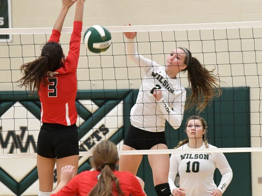Wilson Memorial's Cassidy Davis spikes the ball past East Rockingham's Sarah Johnson during a Shenandoah District championship match played in Fishersville on Monday, October 29, 2018.