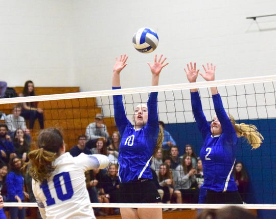 Fort Defiance's Catie Cramer, left, and Ashley Humphries go up to block a return by Rockbridge County's Kriston Whitesell during the first set of the championship match in the Valley District Volleyball Tournament on Monday, Oct. 29, 2018, at Rockbridge County High School in Lexington, Va. The Indians fell to the Wildcats in three sets.