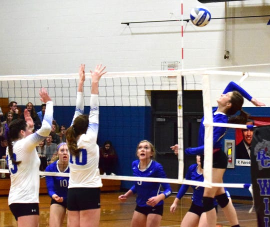 Fort Defiance's Casey Mozingo spikes the ball as Rockbridge County's Graceon Armstrong, left, and Kriston Whitesell during the first set of the championship match in the Valley District Volleyball Tournament on Monday, Oct. 29, 2018, at Rockbridge County High School in Lexington, Va. The Indians fell to the Wildcats in three sets.